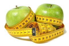Green apple and measure tape Royalty Free Stock Photos