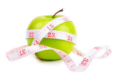 Green apple and measure tape Stock Photography