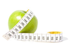 Green apple with measure-tape Stock Photo