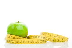 Green apple with measure tape Stock Image