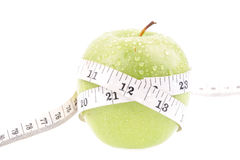 Green apple measured the meter Royalty Free Stock Photography