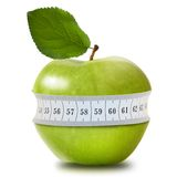Green apple with measurement Royalty Free Stock Photo