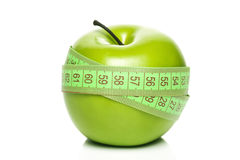 Green apple with measurement Stock Photography