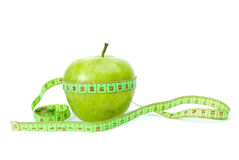 Green apple and measurement tape Stock Photos