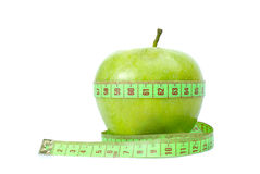 Green apple and measurement tape Royalty Free Stock Photography