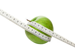 Green apple with measurement tape Royalty Free Stock Photography