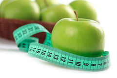 Green apple and measuring tape Stock Photos