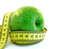 Green apple with measuring tape Stock Photography