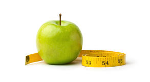 Green apple and measuring tape Royalty Free Stock Image