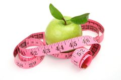 Green apple and measuring tape Stock Photography