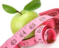 Green apple and measuring tape Royalty Free Stock Photography