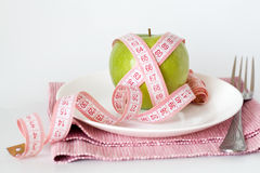 Green apple and measuring tape Royalty Free Stock Images