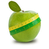 Green apple with measuring tape Royalty Free Stock Photo