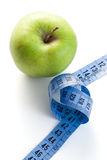Green apple with measuring tape Royalty Free Stock Photos
