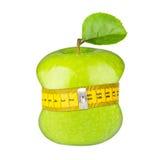 Green apple measuring tape diet concept Stock Photos
