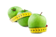 Green apple with Measuring Tape Royalty Free Stock Images