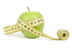Green apple with a measuring tape and heart symbol isolated Royalty Free Stock Image