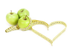 Green apple with a measuring tape and heart symbol isolated Stock Photo