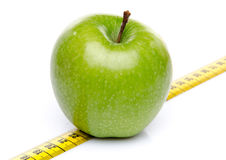 Green apple on a measuring tape Stock Image