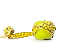 Green apple with measuring tape Stock Images