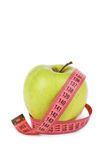 Green apple with measuring tape isolated on white background Stock Image