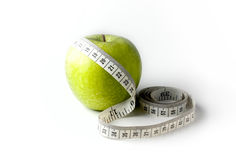 Green apple with measuring tape isolated on white background Stock Photos