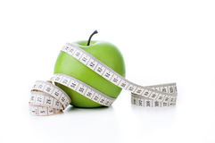Green apple with measuring tape Stock Photos