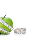 Green apple with measuring tape Stock Image