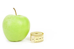 Green apple and measuring tape isolated on white background Stock Photography