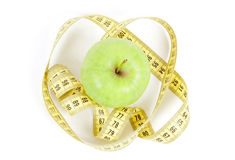 Green apple and measuring tape isolated on white background Stock Images