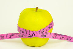 Green Apple With A Measuring Tape Royalty Free Stock Images