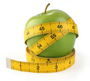 Green apple with measuring tape Stock Photo