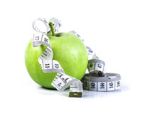 Green apple with Measuring tape on white background in concept o Stock Photography