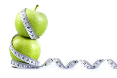 Green apple with Measuring tape on white background in concept o Stock Image