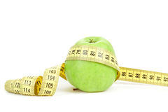 Green apple and measuring tape  on white background Stock Images