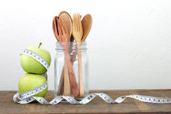 Green apple with Measuring tape on wooden background in concept Royalty Free Stock Photo