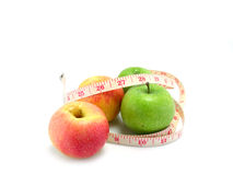 Green apple and measuring tape Royalty Free Stock Photos