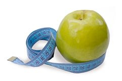 Green apple and measuring waist Stock Image