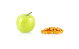 Green apple and medical tablets isolated Royalty Free Stock Image