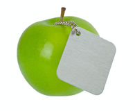 Green apple with metal tag Stock Photos