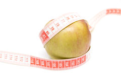 Green apple with a meter Royalty Free Stock Photos