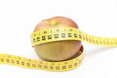 Green apple with a meter Royalty Free Stock Photography