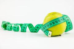Green apple with meter Stock Images