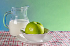 Green apple and milk as healthy lifestyle concept Stock Photo
