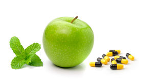 Green apple mint  and pills capsules Royalty Free Stock Image