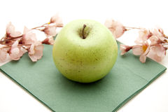 Green apple with napkin Royalty Free Stock Photography