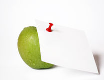 Green apple and note paper Royalty Free Stock Image