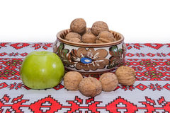 Green apple and nuts Royalty Free Stock Photos