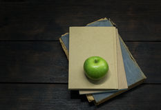 Green apple and old books Royalty Free Stock Photos
