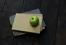 Green apple and old books Stock Photo